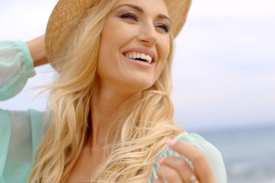 Blond Woman Wearing Sun Hat at Shore